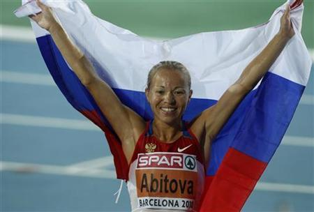 Inga Abitova of Russia celebrates after winning the silver medal in the women's 10,000 metres final at the European Athletics Championships in Barcelona July 28, 2010. REUTERS/Albert Gea
