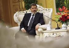 Egypt's President Mohamed Mursi speaks with China's Vice President Xi Jinping (not pictured) during their meeting at the Great Hall of the People, in Beijing August 29, 2012. REUTERS/How Hwee Young/Pool