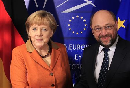 Germany's Chancellor Angela Merkel (L) is welcomed by European Parliament President Martin Schulz in Brussels November 7, 2012. Merkel is holding meetings with several political groups at the European Parliament on Wednesday. REUTERS/Yves Herman