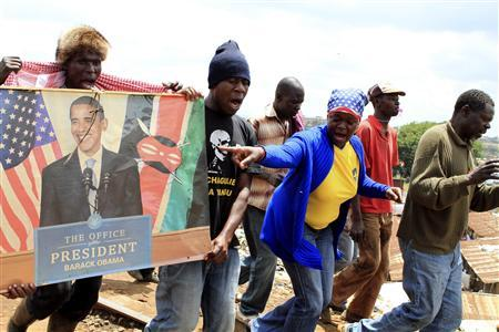 People celebrate the re-election of US President Barack Obama at the sprawling Kibera slums of Kenya's capital Nairobi, November 7, 2012. President Obama won a second term in the White House on Tuesday, overcoming deep doubts among voters about his handling of the U.S. economy to score a clear victory over Republican challenger Mitt Romney. REUTERS/Noor Khamis