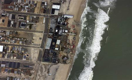 The Funtime Pier Amusement park, including its partially submerged roller coaster, is seen in the aftermath of Hurricane Sandy in Seaside Heights, New Jersey, in this October 31, 2012 handout satellite photo courtesy of NOAA. REUTERS/NOAA/Handout