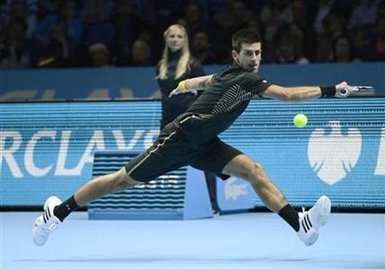 Serbia's Novak Djokovic hits a return to Britain's Andy Murray during their men's singles tennis match at the ATP World Tour Finals in the O2 Arena in London November 7, 2012. REUTERS/Dylan Martinez