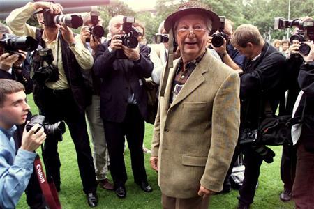 Clive Dunn, star of the BBC's World War II show Dad's Army, is surrounded by photographers at the Imperial War Museum in London July 31. DM/KM