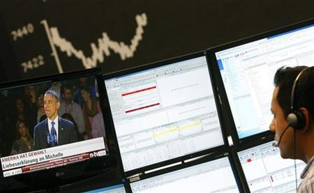 A share trader looks at a TV showing news on re-elected U.S. President Barack Obama in front of the German share price index DAX board at the German stock exchange in Frankfurt November 7, 2012. REUTERS/Lisi Niesner