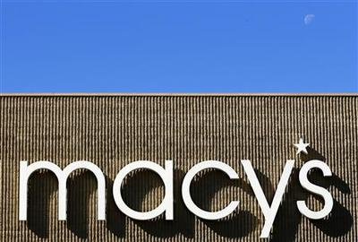 Macy's reports higher profit, Sandy weighs on forecast