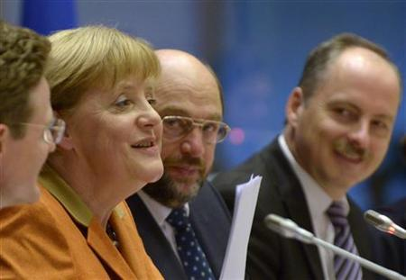 German Chancellor Angela Merkel (2nd L) addresses political groups at the European Parliament in Brussels November 7, 2012. REUTERS/Eric Vidal