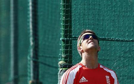 England's Graeme Swann prepares to bowl in the nets during a practice session ahead of their third one-day international cricket match against India in Mohali October 19, 2011. REUTERS/Adnan Abidi/Files