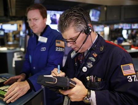 Traders work on the floor of the New York Stock Exchange, soon after the opening bell, November 7, 2012. REUTERS/Chip East