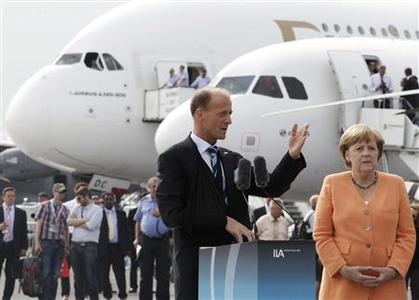 Airbus President and CEO Thomas Enders speaks as German Chancellor Angela Merkel (R) listens, during the opening day of the ILA Berlin Air Show in Selchow, near Schoenefeld, south of Berlin, in this September 11, 2012 file picture. REUTERS/Tobias Schwarz/Files