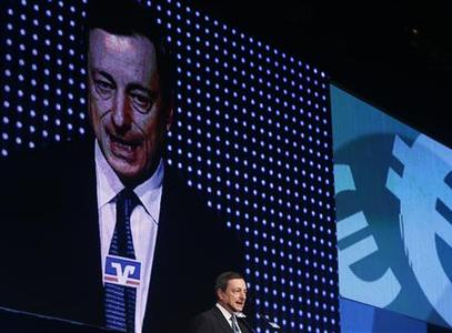 European Central Bank President Mario Draghi speaks during the Economy Day 2012 in Frankfurt November 7, 2012. The European Central Bank's new bond-buying programme allows for unlimited interventions in sovereign debt markets and should dispel concerns about a euro zone break-up, Draghi said on Wednesday. REUTERS/Ralph Orlowski