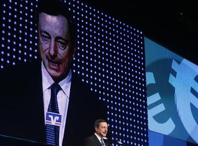 Draghi says ECB plan allows for unlimited bond buys