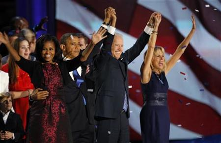 U.S. President Barack Obama and first lady Michelle Obama celebrate with Vice President Joe Biden (2ndR) and Dr. Jill Biden (R) at their election night victory rally in Chicago, November 7, 2012. REUTERS/Jim Bourg
