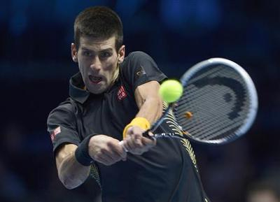 Djokovic fights back to beat Murray at Tour Finals