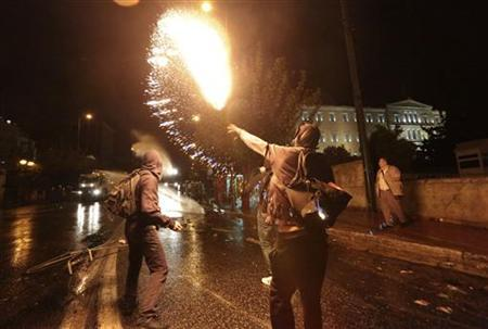 A protestor throws a molotov cocktail at riot police during a 48-hour strike by the two major Greek workers unions in central Athens November 7, 2012. REUTERS/Costas Baltas