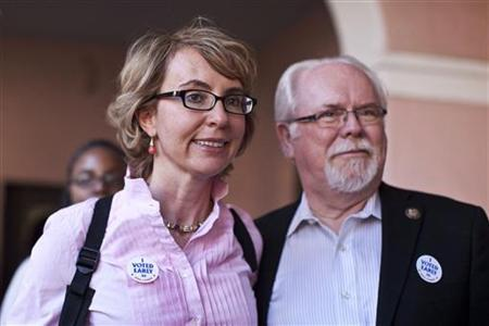 Former congresswoman Gabrielle Giffords and Congressman Ron Barber leave the Pima County Recorder's office after casting their ballots in downtown Tucson, Arizona November 5, 2012. REUTERS/Samantha Sais