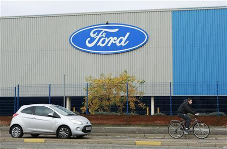 Traffic passes the Ford stamping plant in Dagenham, Essex October 25, 2012. REUTERS/Olivia Harris