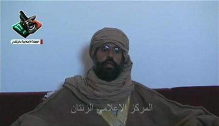 A still image taken from video shows Saif al-Islam Gaddafi speaking during an interview in Zintan November 20, 2011. REUTERS/Zintan Media Council via Reuters TV