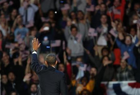 U.S. President Barack Obama acknowledges supporters while addressing his election night victory rally in Chicago, November 7, 2012. REUTERS/Philip Scott-Andrews