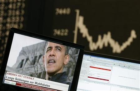 A TV showing news on re-elected U.S. President Barack Obama is pictured in front of the German share price index DAX board at the German stock exchange in Frankfurt November 7, 2012. REUTERS/Lisi Niesner