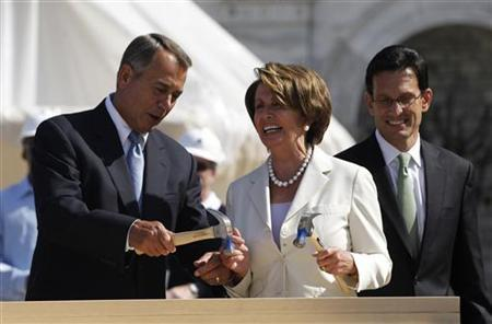U.S. House Minority Leader Nancy Pelosi (C) (D-CA) reacts as U.S. House Speaker John Boehner (L) (R-OH) helps hammer in her nail, as House Majority Leader Eric Cantor (R-VA) watches on, during a ceremony for the Presidential Inauguration construction on the west front of the U.S. Capitol in Washington, September 20, 2012. REUTERS/Jason Reed