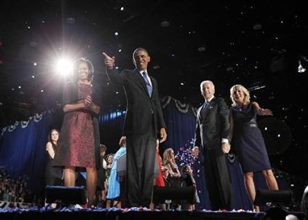 U.S. President Barack Obama (2nd L) celebrates with his wife Michelle, his Vice President Joe Biden and Biden's wife Jill (L-R) after winning the U.S. presidential election in Chicago, Illinois November 7, 2012. REUTERS/Jason Reed