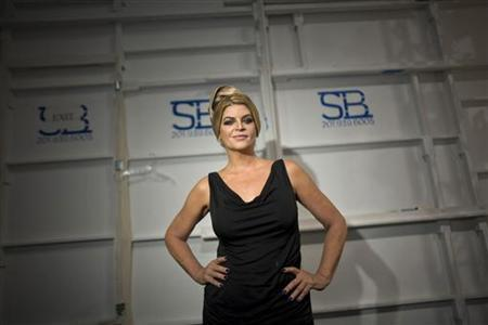 Actress Kirstie Alley poses for a photograph backstage before the Zang Toi Spring/Summer 2012 show during New York Fashion Week September 13, 2011. REUTERS/Allison Joyce/Files