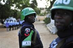 African Union Mission in Somalia (AMISOM) policemen look on they travel to General Kaahiye Police Academy to hand out supplies to the Somali police in Mogadishu, in this October 14, 2012 handout photo taken and released by the African Union-United Nations Information Support Team. REUTERS/AU-UN IST Photo/Tobin Jones/Handout