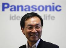 Panasonic Corp's new president Kazuhiro Tsuga poses in front of the company's logo before his interview in Tokyo July 9, 2012. REUTERS/Kim Kyung-Hoon