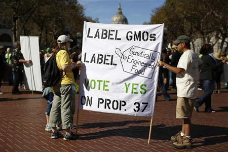 Two demonstrators hold a sign during a rally in support of the state's upcoming Proposition 37 ballot measure in San Francisco, California October 6, 2012. REUTERS/Stephen Lam
