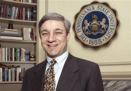 Former Penn State University President Graham Spanier poses in his office in the Old Main building in State College, Pennsylvania, in this February 26, 1997 file photo. REUTERS/Craig Houtz/Files