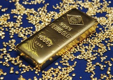 A gold bar and granules are pictured at the Austrian Gold and Silver Separating Plant 'Oegussa' in Vienna October 23, 2012. REUTERS/Heinz-Peter Bader/Files