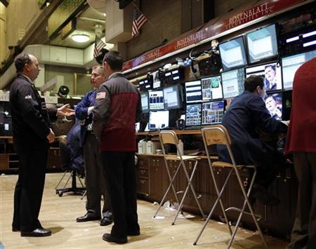 Trading specialists work on the floor of the New York Stock Exchange, soon after the opening bell, November 7, 2012. REUTERS/Chip East
