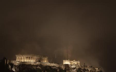 The Acropolis hill with the Parthenon temple is covered with smoke during during a violent demonstration in central Athens November 7, 2012. Greek police fired teargas and water cannons to disperse thousands of protesters who flooded into the main square before parliament on Wednesday in a massive show of anger against lawmakers due to narrowly pass an austerity package. REUTERS/John Kolesidis