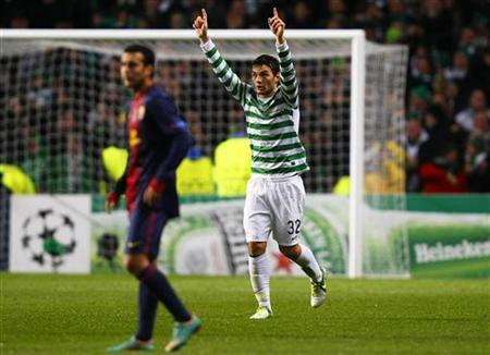 Celtic's Tony Watt (R) celebrates his goal during their Champions League soccer match against Barcelona at Celtic Park stadium in Glasgow, Scotland November 7, 2012. REUTERS/David Moir