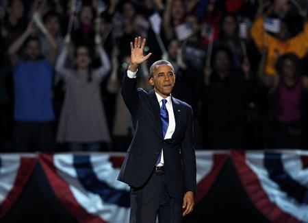 U.S. President Barack Obama, who won a second term in office by defeating Republican presidential nominee Mitt Romney, waves as he addresses supporters during his election night victory rally in Chicago, November 7, 2012. REUTERS/Jeff Haynes
