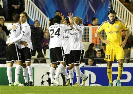 Valencia's players celebrate a goal next to BATE Borisov's Filipenko during their Champions League Group F soccer match at the Mestalla Stadium in Valencia, November 7, 2012. REUTERS/Heino Kalis