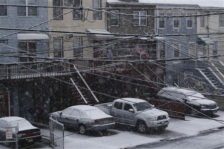 Cars are seen covered by snow during the arrival of Nor'easter, also known as a northeaster storm, in Jersey City, New Jersey, November 7, 2012. A wintry storm dropped snow on the Northeast and threatened to bring dangerous winds and flooding to a region still climbing out from the devastation of superstorm Sandy. REUTERS/Eduardo Munoz
