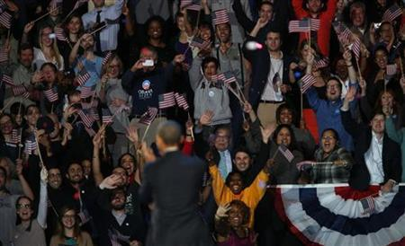 Supporters cheer U.S. President Barack Obama after he gave his victory speech during his election night rally in Chicago, November 7, 2012. REUTERS/Philip Andrews