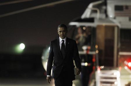 U.S. President Barack Obama walks to Air Force One at JFK Airport October 18, 2012, after attending the 67th Annual Alfred E. Smith Memorial Foundation dinner. REUTERS/Jason Reed