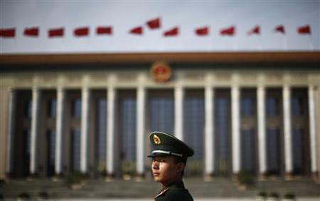 A paramilitary police officer stands in front of the Great Hall of the People at Beijing's Tiananmen Square, November 7, 2012. REUTERS/Carlos Barria