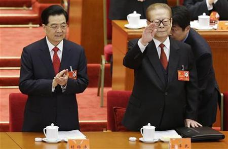 Chinese President Hu Jintao (L) applauds as former Chinese President Jiang Zemin waves before the opening ceremony of 18th National Congress of the Communist Party of China at the Great Hall of the People in Beijing November 8, 2012. REUTERS/Jason Lee