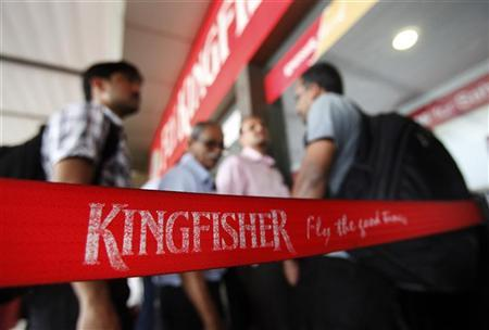 Customers stand at a Kingfisher Airlines reservation office at the domestic airport in Mumbai March 20, 2012. REUTERS/Vivek Prakash/Files