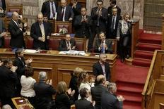Greece's Prime Minister Antonis Samaras (blue tie) applauds with lawmakers after a vote at the parliament in Athens November 8, 2012. Greece's government secured enough votes in parliament on Thursday to pass deeply unpopular austerity measures essential to unlocking further aid from foreign lenders. REUTERS/Yorgos Karahalis (GREECE - Tags: POLITICS BUSINESS)