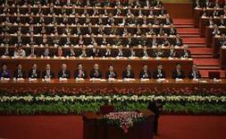 Delegates applaud as China's President Hu Jintao bows after speech at the opening ceremony of 18th National Congress of the Communist Party of China at the Great Hall of the People in Beijing, November 8, 2012. REUTERS/Jason Lee (CHINA - Tags: POLITICS)