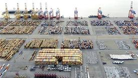 Cars and containers are pictured at a shipping terminal in the harbour of the German northern town of Bremerhaven, late October 8, 2012. Export vehicles from Europe are transported to all parts of the world through Bremerhaven, which is one of the biggest automobile ports in the world. REUTERS/Fabian Bimmer (GERMANY - Tags: TRANSPORT BUSINESS)