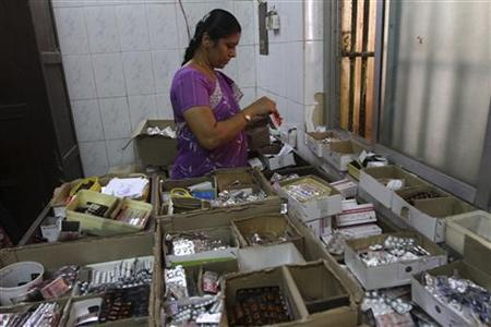 A pharmacists sorts free medication provided by the government, which will be given to patients, at Rajiv Gandhi Government General Hospital (RGGGH) in Chennai July 12, 2012. REUTERS/Babu/Files