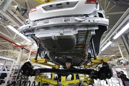 An employee works at the Beiqi E150EV car assembly line of Beijing Electric Vehicle Company, in Beijing November 7, 2012. REUTERS/Jason Lee