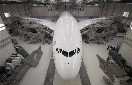 A new Airbus A380 airliner for Lufthansa is ready to leave the paintshop hangar at the Airbus facility in Finkenwerder near Hamburg, in this February 5, 2010 file picture. REUTERS/Files/Christian Charisius