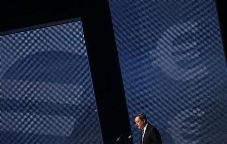 European Central Bank President Mario Draghi speaks during the Economy Day 2012 in Frankfurt November 7, 2012. The European Central Bank's new bond-buying programme allows for unlimited interventions in sovereign debt markets and should dispel concerns about a euro zone break-up, Draghi said on Wednesday. REUTERS/Ralph Orlowski (GERMANY - Tags: BUSINESS TPX IMAGES OF THE DAY)