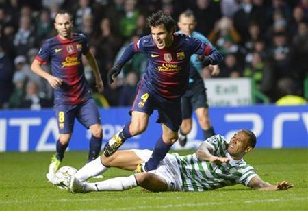 Celtic's Kelvin Wilson (R) challenges Barcelona's Cesc Fabregas during their Champions League Group G soccer match at Celtic Park, Glasgow in Scotland, November 7, 2012. REUTERS/Russell Cheyne